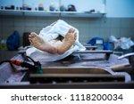 feet of an unclaimed body... | Shutterstock . vector #1118200034