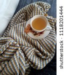 teacup on blanket with biscuits | Shutterstock . vector #1118201444