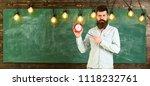 teacher in eyeglasses holds... | Shutterstock . vector #1118232761