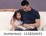 daddy reading his little girl... | Shutterstock . vector #1118264651