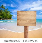 Wooden Signboard On Tropical...