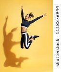 happy athletic woman jumping up ... | Shutterstock . vector #1118376944