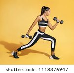 sporty latin woman in black... | Shutterstock . vector #1118376947