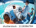 young captain steers sailing... | Shutterstock . vector #1118386784