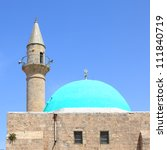 Muslim mosque and minaret in the Old city of Acre (Akko), Mediterranean, Israel - stock photo