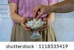 the woman holding and offering... | Shutterstock . vector #1118535419