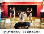 girls praising a theater class... | Shutterstock . vector #1118556254