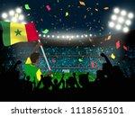supporter hold senegal flag... | Shutterstock .eps vector #1118565101