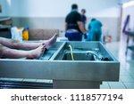 feet of an unclaimed body... | Shutterstock . vector #1118577194