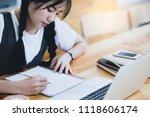 university asian girl working... | Shutterstock . vector #1118606174