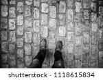 feet on cobblestones  detail of ... | Shutterstock . vector #1118615834