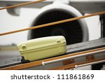 The baggage on the conveyor belt to the airplane. - stock photo