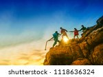 young asian couple climbing up... | Shutterstock . vector #1118636324