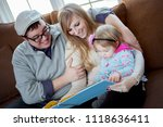 portrait of an adorable family... | Shutterstock . vector #1118636411