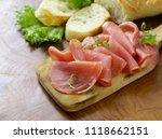 smoked ham of pork on a wooden... | Shutterstock . vector #1118662151