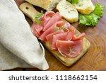 smoked ham of pork on a wooden... | Shutterstock . vector #1118662154