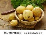 fresh organic raw potatoes in a ... | Shutterstock . vector #1118662184
