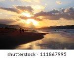 people walk on the beach | Shutterstock . vector #111867995
