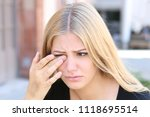 woman with eye problems outside | Shutterstock . vector #1118695514