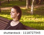 beautiful girl sits on a park... | Shutterstock . vector #1118727545