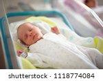 newborn male baby sleeping... | Shutterstock . vector #1118774084