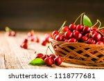 cherry in wooden basket with... | Shutterstock . vector #1118777681