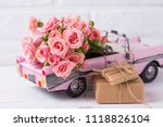 retro car toy with pink roses... | Shutterstock . vector #1118826104