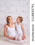 pregnant mother with her... | Shutterstock . vector #1118835791