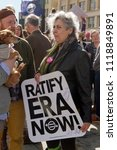 Small photo of ASHEVILLE, NORTH CAROLINA, USA - JANUARY 20, 2018: A female Baby Boomer in the 2018 Women's March holds a sign demanding the Equal Rights Amendment to the American Constitution be passed