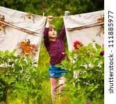 Stock photo little five year girl with clothespin outdoor 111885977