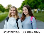 two girl friends schoolgirl.... | Shutterstock . vector #1118875829