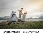 parent with young daughters and ... | Shutterstock . vector #1118904965