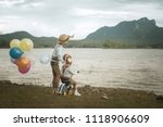 happy boy and brother with... | Shutterstock . vector #1118906609