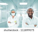 Scientists team at modern hospital lab, group of multiracial doctors - stock photo