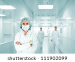 Medical active staff in hospital - stock photo