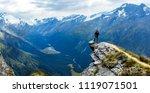 traveler standing at the edge... | Shutterstock . vector #1119071501