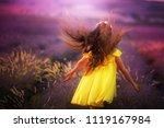 smiling girl sniffing flowers... | Shutterstock . vector #1119167984