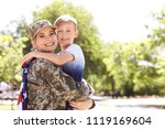 American Soldier With Her Son...