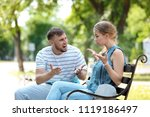 young couple arguing while...   Shutterstock . vector #1119186497