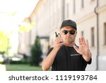 male security guard using... | Shutterstock . vector #1119193784