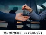 woman give car key to man.... | Shutterstock . vector #1119207191