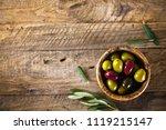 olives on olive branch. wooden...   Shutterstock . vector #1119215147