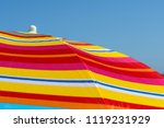 colorful beach umbrella on a... | Shutterstock . vector #1119231929