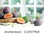 Ripe Sweet Figs With Leaves In...