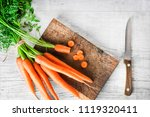 ripe carrot top view on wooden... | Shutterstock . vector #1119320411