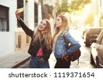two beautiful girlfriends... | Shutterstock . vector #1119371654