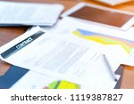 contract document on table with ... | Shutterstock . vector #1119387827
