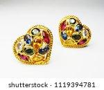 gold earrings setting heart... | Shutterstock . vector #1119394781