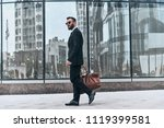pure confidence. full length of ... | Shutterstock . vector #1119399581