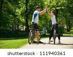 happy couple ride bicycle... | Shutterstock . vector #111940361
